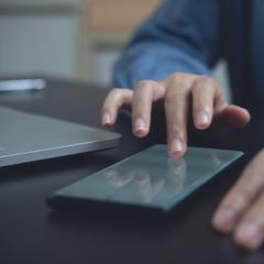 man digitally signing on phone