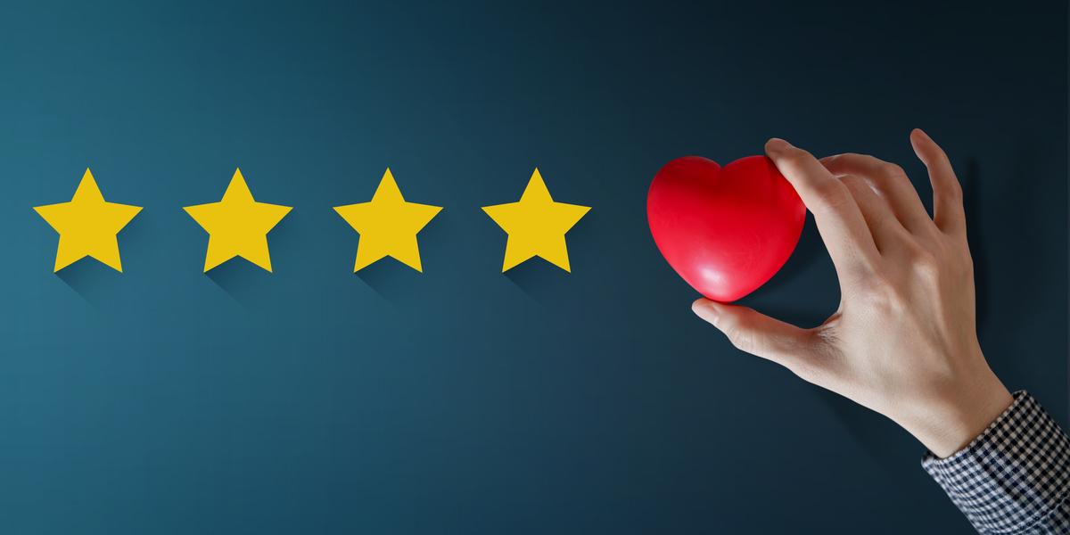 four stars, hand holding heart